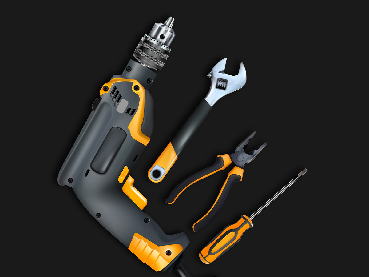 Professional locksmith tools, a drill, adjustable wrench, screwdriver, and pliers