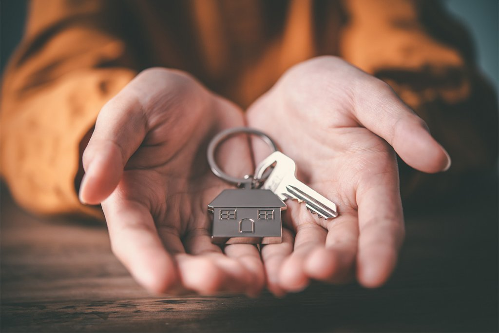 A Spare Key Benefits - A Concept - Hands Hold a Keys to the House